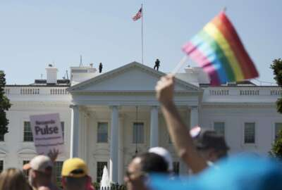 FILE - In this Sunday, June 11, 2017 file photo, Equality March for Unity and Pride participants march past the White House in Washington. The Biden administration says the government will protect gay and transgender people against sex discrimination in health care. That reverses a Trump-era policy that sought to narrow the scope of legal rights in sensitive situations involving medical care. Health and Human Services Secretary Xavier Becerra said Monday that LGBTQ people should have the same access to health care as everyone else. T(AP Photo/Carolyn Kaster)