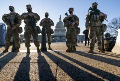 In this file photo from Wednesday, March 3, 2021, members of the Michigan National Guard join the U.S. Capitol Police to keep watch over the Capitol grounds in Washington, in the wake of the Jan. 6 insurrection by a mob loyal to former President Donald Trump. The Guard mission is ending as Democrats and Republicans spar over whether to form an independent bipartisan commission to investigate the attack that sought to overturn Trump's loss to Joe Biden. (AP Photo/J. Scott Applewhite, file)