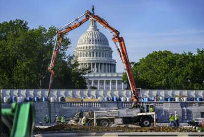 A concrete pump frames the Capitol Dome during renovations and repairs to Lower Senate Park on Capitol Hill in Washington, Tuesday, May 18, 2021. President Joe Biden hopes to pass a massive national infrastructure plan by this summer but Democrats and Republicans in Congress appear divided over his proposal for $2.3 trillion in spending to upgrade the nation's crumbling infrastructure. (AP Photo/J. Scott Applewhite)