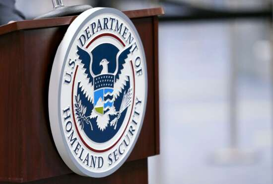 FILE - In this Nov. 20, 2020, file photo a U.S. Department of Homeland Security plaque is displayed a podium as international passengers arrive at Miami international Airport where they are screened by U.S. Customs and Border Protection in Miami. The Department of Homeland Security plans to ramp up its social media tracking as part of an enhanced focus on domestic violent extremism. The move is a response ding to weaknesses exposed by the deadly Capitol insurrection but also raising longstanding concerns about protecting Americans' civil liberties. (AP Photo/Lynne Sladky, File)