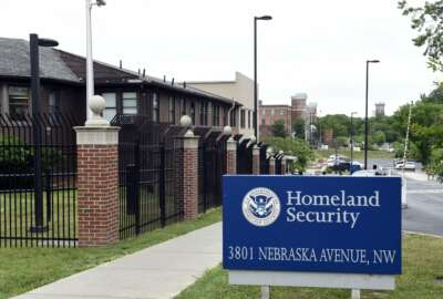 FILE - This June 5, 2015, file photo, shows a view of the Homeland Security Department headquarters in Washington. Less than a year after being on the verge of furloughing about 70% of employees to plug a funding shortfall, the federal agency that grants citizenship, green cards and temporary visas wants to improve service without a detailed plan to pay for it, including waivers for those who can't afford to pay fees, according to a proposal obtained by The Associated Press. (AP Photo/Susan Walsh, File)