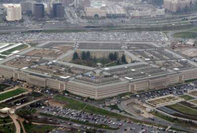 FILE - In this March 27, 2008, file photo, the Pentagon is seen in this aerial view in Washington. Officials say the Pentagon is reconsidering how to make a massive shift to cloud computing, suggesting the possibility that it could scrap a contract potentially worth $10 billion. (AP Photo/Charles Dharapak, File)