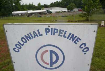 Tanker trucks are parked near the entrance of Colonial Pipeline Company Wednesday, May 12, 2021, in Charlotte, N.C.  Several gas stations in the Southeast reported running out of fuel, primarily because of what analysts say is unwarranted panic-buying among drivers, as the shutdown of a major pipeline by hackers entered its fifth day.  (AP Photo/Chris Carlson)
