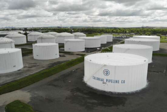 Colonial Pipeline storage tanks are seen in Woodbridge, N.J., Monday, May 10, 2021. Gasoline futures are ticking higher following a cyberextortion attempt on the Colonial Pipeline, a vital U.S. pipeline that carries fuel from the Gulf Coast to the Northeast. (AP Photo/Ted Shaffrey)