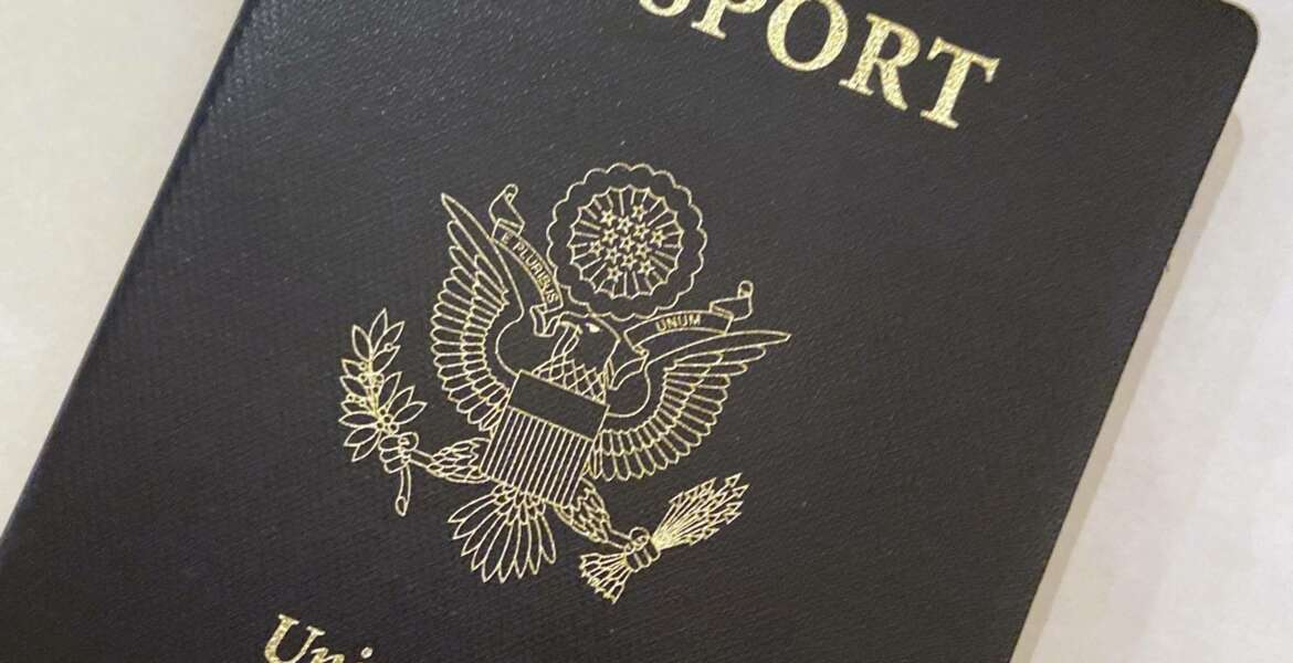 This May 25, 2021 photo shows a U.S. Passport cover in Washington.  The Biden administration says American citizens holding recently expired U.S. passports will be allowed to return home from abroad on that document until the end of year. (AP Photo/Eileen Putman)
