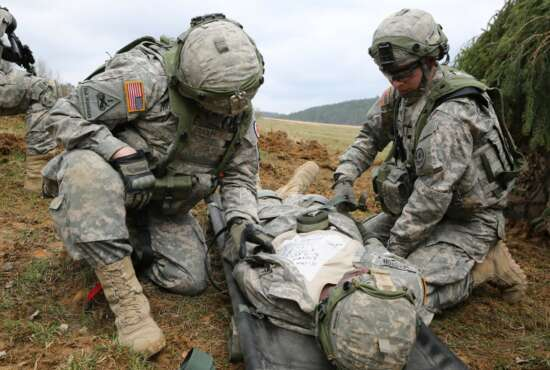 U.S. Soldiers assigned to Bravo Troop, 1st Squadron, 2nd Cavalry Division strap in a simulated wounded Soldier to a litter while conducting a movement to contact drill during exercise Saber Junction 15 at the U.S. Army's Joint Multinational Readiness Center in Hohenfels, Germany, April 12, 2015. Saber Junction 15 prepares NATO and partner nation forces for offensive, defensive, and stability operations and promotes interoperability among participants. Saber Junction 15 has more than 4,700 participants from 17 countries, to include: Albania, Armenia, Belgium, Bosnia, Bulgaria, Great Britain, Hungary, Latvia, Lithuania, Luxembourg, Macedonia, Moldova, Poland, Romania, Sweden, Turkey, and the U.S. (U.S. Army photo by Spc. Brian Chaney/Released) (Spc. Brian Chaney)