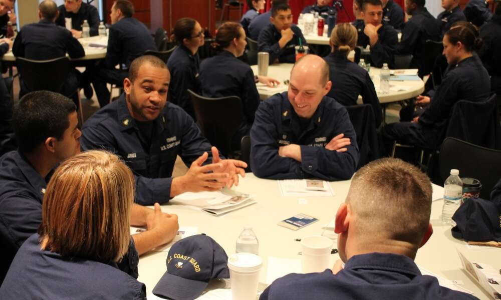 Chief Petty Officer Paul Jones, executive officer at Aids to Navigation Team Two Rivers, Wisconsin, leads a discussion on leadership with his peers at the 3rd annual Women's Leadership Symposium in Milwaukee, March 30, 2017. The symposium brought together leaders from all levels of the service to discuss leadership, mentorship and resources available to contribute to the success of the Coast Guard's missions. (Coast Guard photo by Lt. j.g. Tom Morrell)