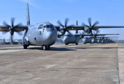 Nineteen C-130J aircraft take part in an elephant walk before takeoff during an exercise Mar. 15, 2018, at Little Rock Air Force Base, Ark. Numerous C-130J units from around the Air Force participated in a training event to enhance operational effectiveness and joint interoperability. (U.S. Air Force photo by Airman 1st Class Rhett Isbell)