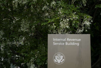 This May 4, 2021, photo shows a sign outside the Internal Revenue Service building in Washington. (AP Photo/Patrick Semansky)