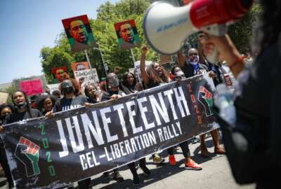 FILE- In this June 19, 2020, file photo, protesters chant as they march after a Juneteenth rally at the Brooklyn Museum, in the Brooklyn borough of New York. (AP Photo/John Minchillo, File)