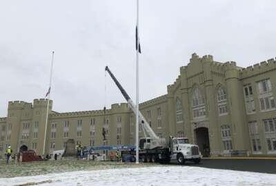 FILE - Crews lift a statue of Confederate Gen. Thomas