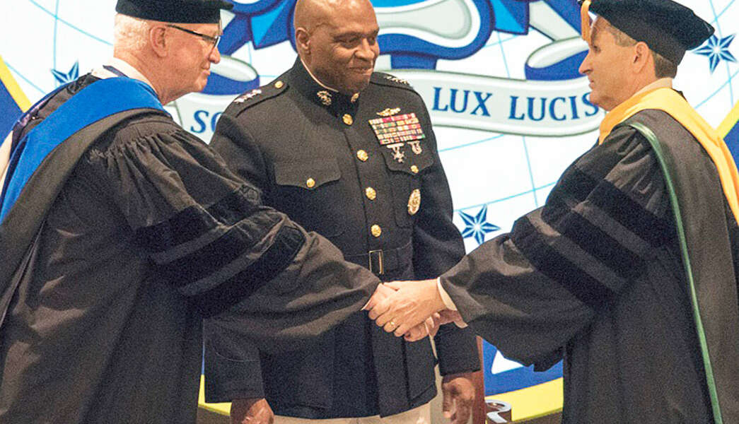 DIA Director Lt. Gen. Vincent Stewart, USMC, (center) presided at the formal change of Presidency as Dr. David R. Ellison (left) transferred the authority, responsibility, and accountability for NIU to Dr. J. Scott Cameron (right) on Friday, 25 August 2017.