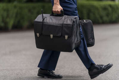 A U.S. military aide carries the