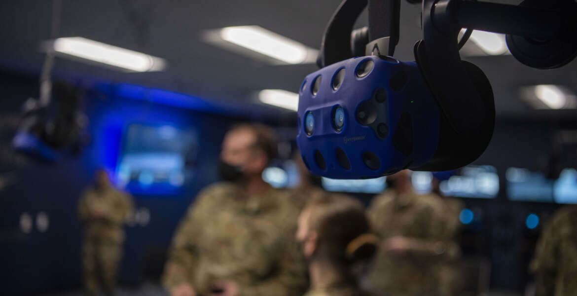 A virtual reality headset hangs from the ceiling at the 317th Maintenance Group VR lab at Dyess Air Force Base, Texas, Mar. 3, 2021. The lab has advanced so far that the Air Education and Training Command for the C-130J Super Hercules crew chiefs' have integrated the Dyess' VR training course into their field training detachment curriculum. (U.S. Air Force photo by Senior Airman Mercedes Porter)