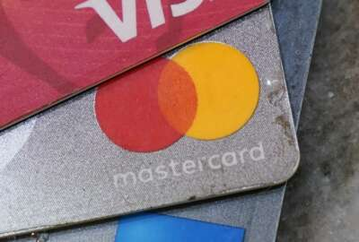 American Express, Visa and Master card cards on display in Richmond, Va., Thursday, July 1, 2021. U.S. consumer borrowing surged by $35.3 billion in May as Americans, bolstered by a reopening economy and rising job levels, went back to using credit in a big way. Borrowing on credit cards and for auto and student loans showed solid gains in May, the Federal Reserve reported Thursday, July 8, 2021. (AP Photo/Steve Helber, file)