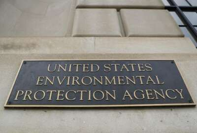 """FILE - In this Sept. 21, 2017, file photo, the Environmental Protection Agency (EPA) Building is shown in Washington. Two high-ranking Trump political appointees at the EPA engaged in fraudulent payroll activities, including payments to employees after they were fired and to one of the officials when he was absent from work, that cost the agency more than $130,000, a report by an internal watchdog says. Former chief of staff Ryan Jackson and former White House liaison Charles Munoz submitted """"official timesheets and personnel forms that contained materially false, fictitious, and fraudulent statements"""