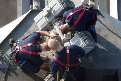 U.S. Navy Fire Controlman 3rd Class Daniel Stone, left, and Fire Controlmen 2nd Class Geoffrey Lee and Nick Sauble perform maintenance on an optical sighting system aboard the guided missile destroyer USS Jason Dunham (DDG 109) in the Arabian Sea Oct. 20, 2012. Jason Dunham was part of the Dwight D. Eisenhower Carrier Strike Group and was under way in the U.S. 5th Fleet area of responsibility conducting maritime security operations, theater security cooperation efforts and support missions as part of Operation Enduring Freedom. (U.S. Navy photo by Cmdr. Michael W. Meredith/Released)