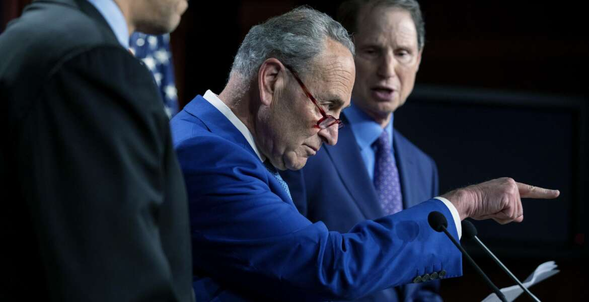 From left, Sen. Cory Booker, D-N.J.,Senate Majority Leader Chuck Schumer, D-N.Y., and Sen. Ron Wyden, D-O.R., announce a draft bill that would decriminalize marijuana on a federal level, Wednesday, July 14, 2021, on Capitol Hill in Washington. (AP Photo/Amanda Andrade-Rhoades)