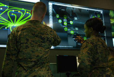 Marines with Marine Corps Forces Cyberspace Command pose for photos in the cyber operations center at Lasswell Hall aboard Fort Meade, Maryland, Feb. 5, 2020. MARFORCYBER Marines conduct offensive and defensive cyber operations in support of United States Cyber Command and operate, secure and defend the Marine Corps Enterprise Network. This image is a photo illustration.