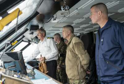 U.S. Army Gen. Paul Nakasone (middle) and Coast Guard Capt. Kevin Carroll (right) get a tour of the bridge aboard the Spirit of Norfolk while transiting to Coast Guard Base Portsmouth, Virginia, March 6, 2020. The two servicemembers were participating in the Cyber Component Commanders' Conference, which served to raise awareness of the importance of maintaining strong cyber security postures within the Coast Guard. (U.S. Coast Guard photo by Seaman Katlin Kilroy)