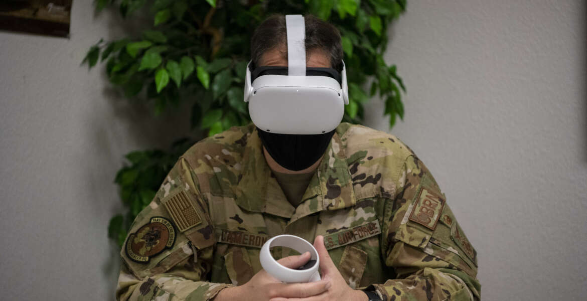 Lt. Col. Glenn Cameron, 60th Civil Engineer Squadron commander, participates in a test-virtual reality program meant to replace the suicidal awareness computer-based training Feb. 18, 2021, at Travis Air Force Base, California. The suicidal prevention training is being tested at Scott and Travis AFBs and is the only training across the Department of Defense of its kind. (U.S. Air Force photo by Nicholas Pilch)