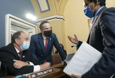 From left, Rep. Ed Perlmutter, D-Colo., Rep. Jamie Raskin, D-Md., and Rep. Joe Neguse, D-Colo., confer after a brief meeting of the House Rules Committee, at the Capitol in Washington, Tuesday, Aug. 24, 2021. (AP Photo/J. Scott Applewhite)