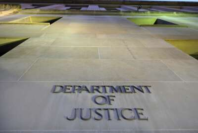 FILE - In this May 14, 2013, file photo, the Department of Justice headquarters building in Washington is photographed early in the morning. The Justice Department said Monday, Aug. 9, 2021, that it would work toward providing families of 9/11 victims with more information about the run-up to the attacks as part of a federal lawsuit that aims to hold the Saudi government accountable. (AP Photo/J. David Ake, File)