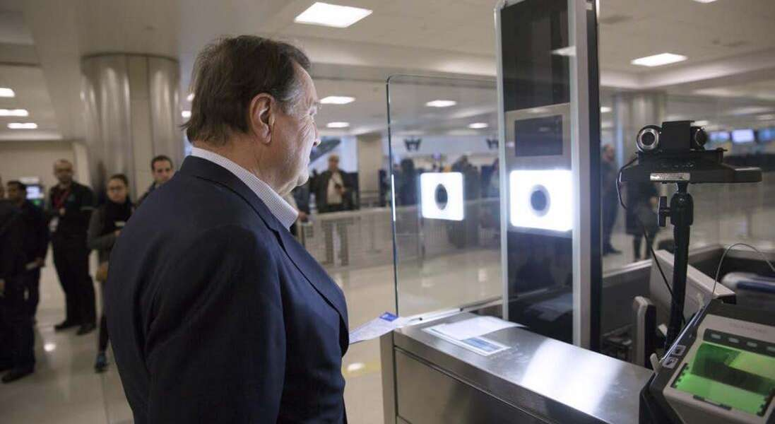 As part of CBP's one-to-one biometric facial recognition testing on inbound, international flights, a traveler has his photo taken and compared against his passport photo to confirm his identity at Dulles Airport. Photo by Glenn Fawcett
