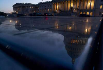 The U.S Capitol is visible after sunset in Washington, Thursday, Sept. 30, 2021. With only hours to spare, Congress passed legislation that would avoid a partial federal shutdown and keep the government funded through Dec. 3, and sent the bill to President Joe Biden.. (AP Photo/Andrew Harnik)