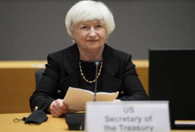 FILE - In this July 12, 2021 file photo, U.S. Treasury Secretary Janet Yellen prepares to speak during a meeting of eurogroup finance ministers at the European Council building in Brussels.   Yellen is telling Congress, Wednesday, Sept. 8,  that she will run out of maneuvering room to keep from broaching the government's borrowing limit during the month of October.   (AP Photo/Virginia Mayo, File)