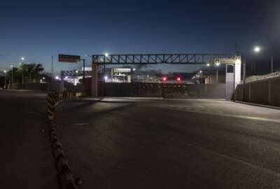 FILE - A view of the border bridge in Ciudad Acuna, Mexico, on Sept. 24, 2021, across the Rio Grande river from Del Rio, Texas. Congressional investigators say two Border Patrol agents were fired from among 60 found to have committed misconduct for participating in a private Facebook group that mocked migrants and lawmakers. (AP Photo/Felix Marquez, File)