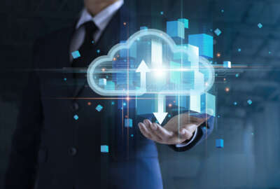 Businessman hand holding cloud computing online connecting to big data analytics. Block chain network technology and intelligence data storage develop smart decision in global business solution.