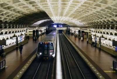 FILE - In this April 23, 2021 file photo, a train arrives at Metro Center station in Washington.  Washington's regional Metro system abruptly pulled more than half its fleet of trains from service early Monday morning over a lingering problem with the wheels and axles that caused a dramatic derailing last week.  (AP Photo/Patrick Semansky)