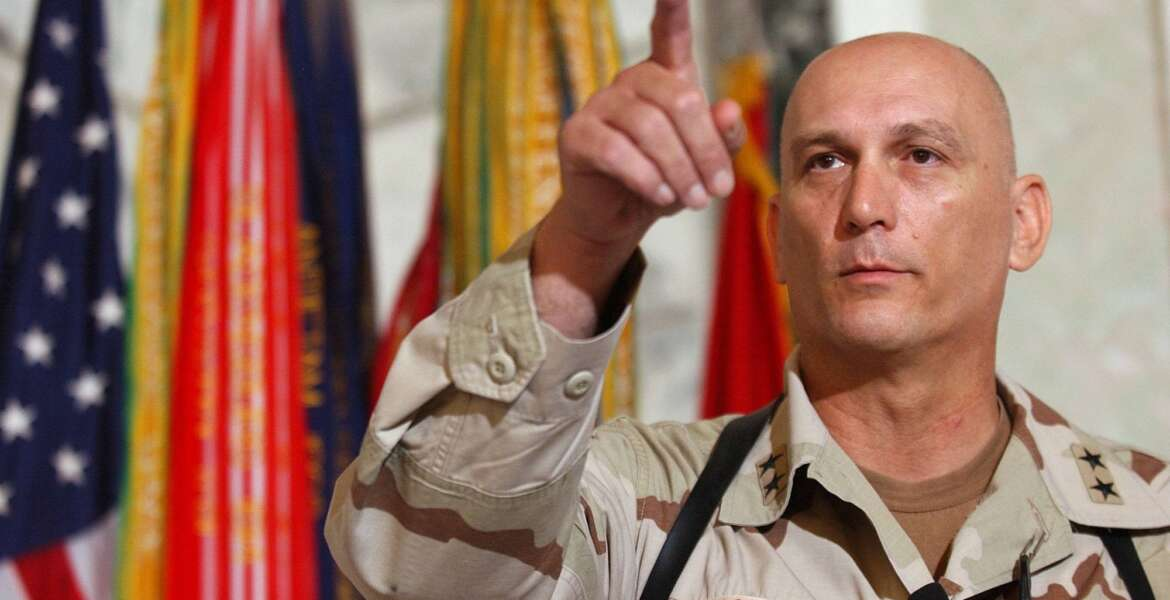 FILE - In this Aug. 7, 2003 file photo, Major General Raymond Odierno, commander of the U.S. Army Fourth Infantry Division gestures during a news conference in Tikrit, about 180 kms. (112 miles) northwest of Baghdad, Iraq.  Odierno, a retired Army general who commanded American and coalition forces in Iraq at the height of the war and capped a 39-year career by serving as the Army's chief of staff, has died, his family said Saturday, Oct. 9, 2021. He was 67.  (AP Photo/Dario Lopez-Mills, File)