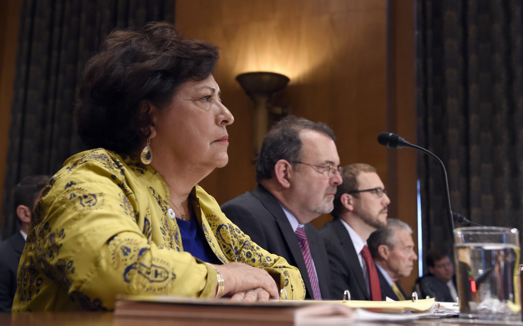 Witnesses, from left, Office of Personnel Management (OPM) Director Katherine Archuleta; OPM Chief Information Officer Tony Scott; Assistant Secretary of Office of Cybersecurity and Communications National Protection and Programs Directorate at the Department of Homeland Security Andy Ozment, and OPM Inspector General Patrick E. McFarland, testify on Capitol Hill in Washington, Thursday, June 25, 2015, before the Senate Homeland Security and Governmental Affairs Committee hearing on federal Cybersecurity and the OPM Data Breach. (AP Photo/Susan Walsh)