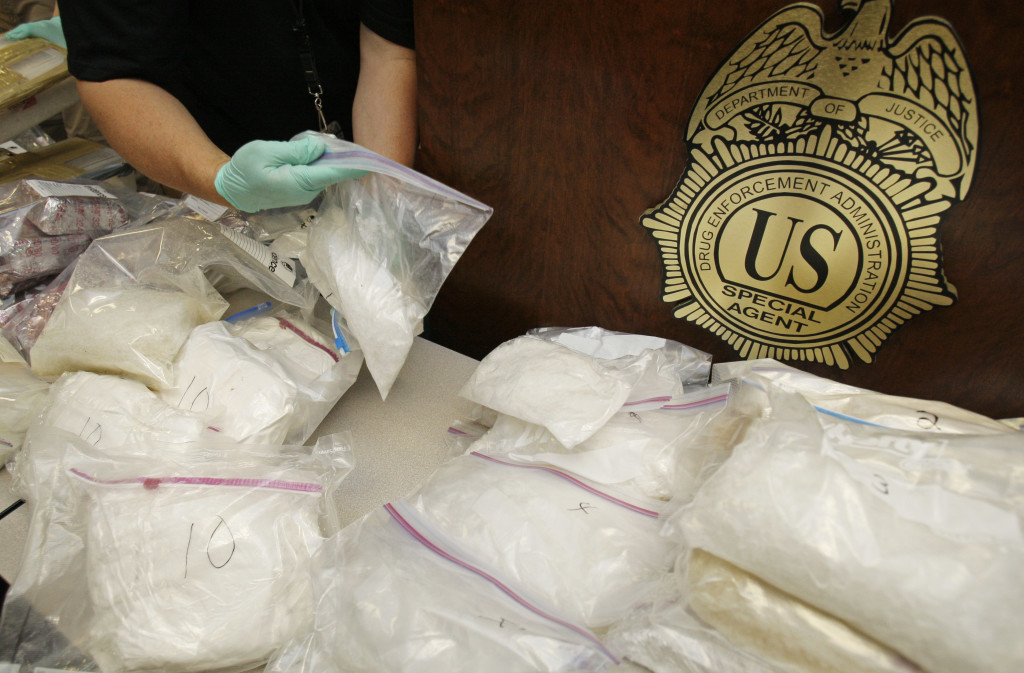 A police officer packs up bags of methamphetamine after a news conference in Atlanta to announce the seizure of an estimated $6 million worth of the drug on Wednesday, May 13, 2009. (AP Photo/John Bazemore)