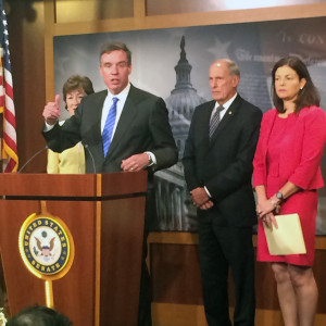Sens. Mark Warner (center), Susan  Collins (left), Dan Coats and Kelly Ayotte introduce the FISMA Reform Act Wednesday.