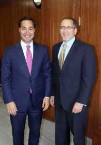 Federal Drive host Tom Temin, right, poses for a photo with HUD Secretary Julian Castro.